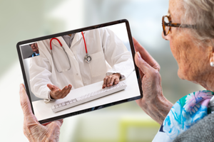photo of a physician and patient in a telemedicine session