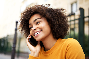 photo of a young woman talking on a cell phone